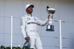 Race winner Lewis Hamilton, Mercedes AMG F1, leaves the podium with his trophy