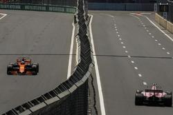 Fernando Alonso, McLaren MCL32 and Esteban Ocon, Sahara Force India VJM10
