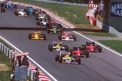 Nigel Mansell, Williams FW11B Honda, leads Gerhard Berger, Ferrari F187, Michele Alboreto, Ferrari F187, Nelson Piquet, Williams FW11B Honda, Alain Prost, McLaren MP4/3 TAG Porsche, and Ayrton Senna, Team Lotus Honda 99T