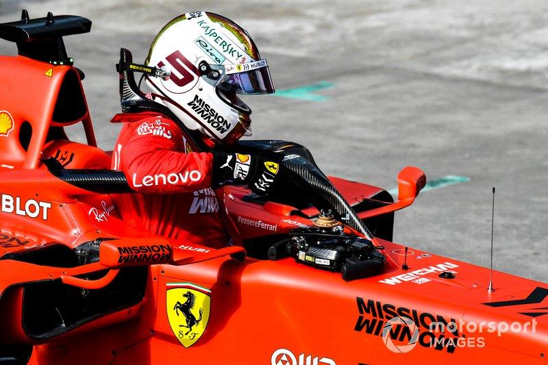 Sebastian Vettel, Ferrari, climbs out of his car after Qualifying