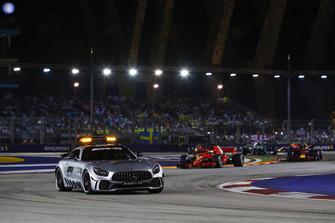 The Safety Car leads Lewis Hamilton, Mercedes AMG F1 W09 EQ Power+, Sebastian Vettel, Ferrari SF71H, Max Verstappen, Red Bull Racing RB14, Valtteri Bottas, Mercedes AMG F1 W09 EQ Power+, and the rest of the field
