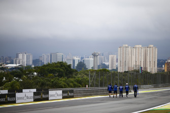 Pierre Gasly, Toro Rosso, and colleagues walk the circuit