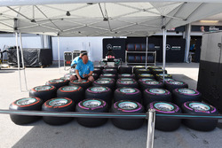 Mercedes AMG F1 mechanic and Pirelli tyres