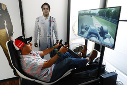A fan tries his hand on an F1 driving sim