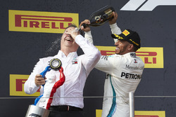 Lewis Hamilton, Mercedes AMG F1, 1st position, pours Champagne aon Ron Meadows, Sporting Director, Mercedes AMG, on the podium