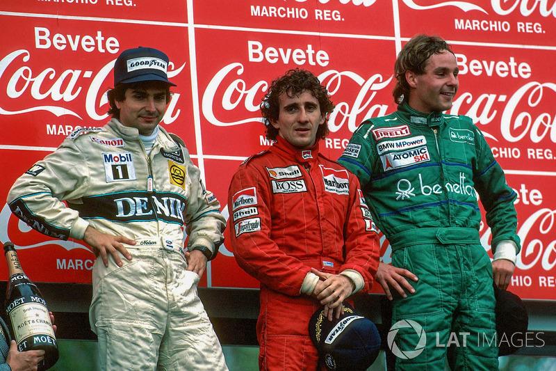 Podium: race winner Alain Prost, second place Nelson Piquet, third place Gerhard Berger