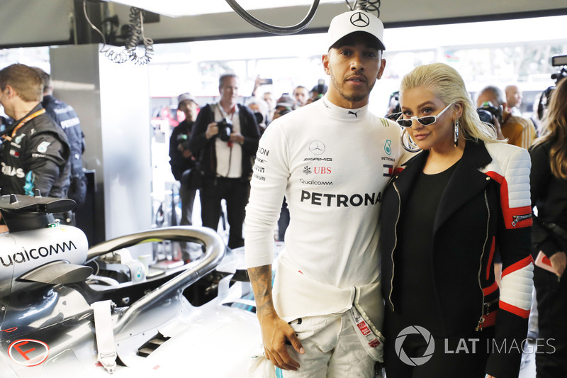 Lewis Hamilton, Mercedes AMG F1, in the garage with singer Christina Aguilera