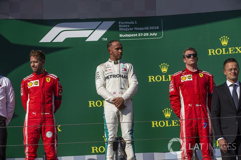 Sebastian Vettel, Ferrari, Lewis Hamilton, Mercedes-AMG F1 y Kimi Raikkonen, Ferrari en el podio