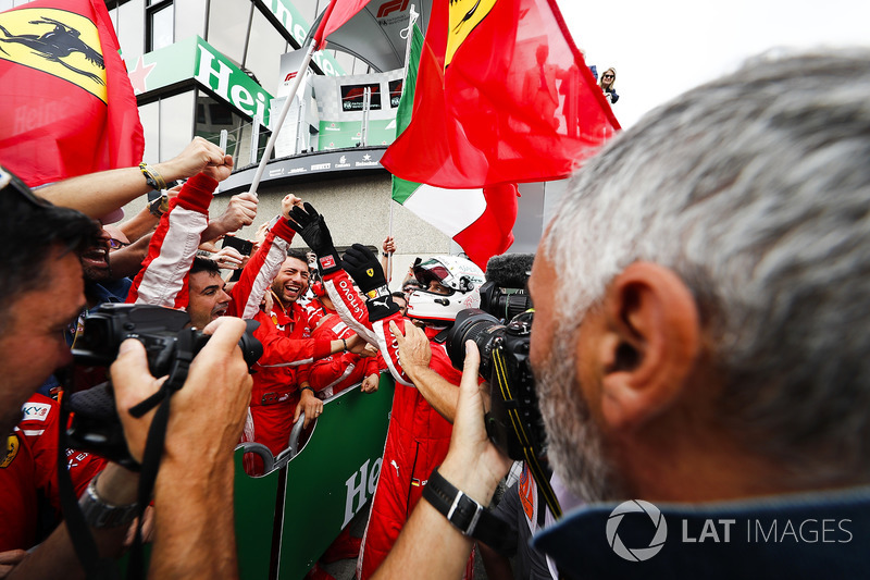 Sebastian Vettel, Ferrari, 1st position, celebrates with his team on arrival in Parc Ferme