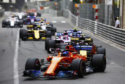 Fernando Alonso, McLaren MCL33, leads Carlos Sainz Jr., Renault Sport F1 Team R.S. 18, Sergio Perez, Force India VJM11