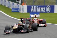 Sébastien Buemi, Toro Rosso STR5, leads Fernando Alonso, Ferrari F10