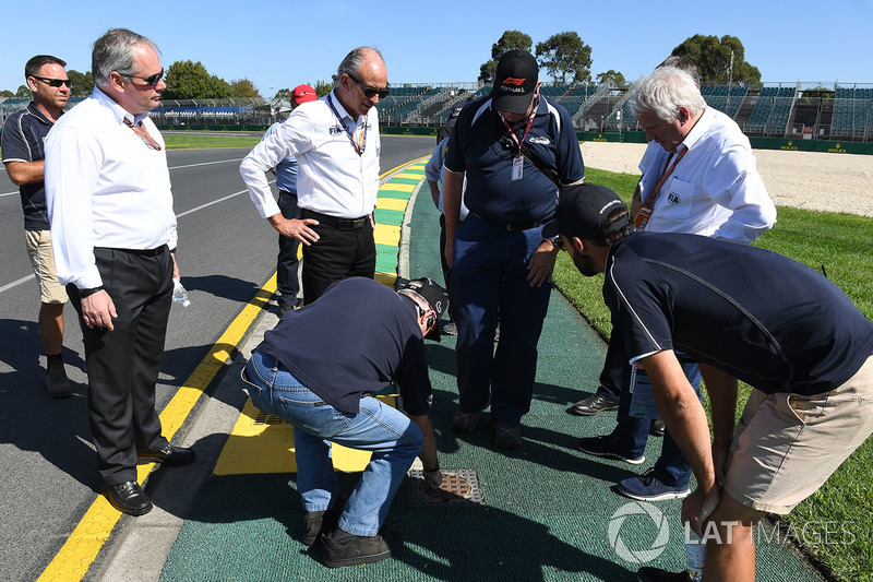 Charlie Whiting, FIA Delegate inspects the track and kerbs