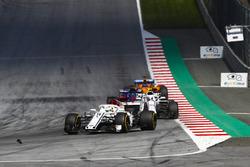 Marcus Ericsson, Sauber C37, Sergey Sirotkin, Williams FW41, Fernando Alonso, McLaren MCL33, as they approach some debris