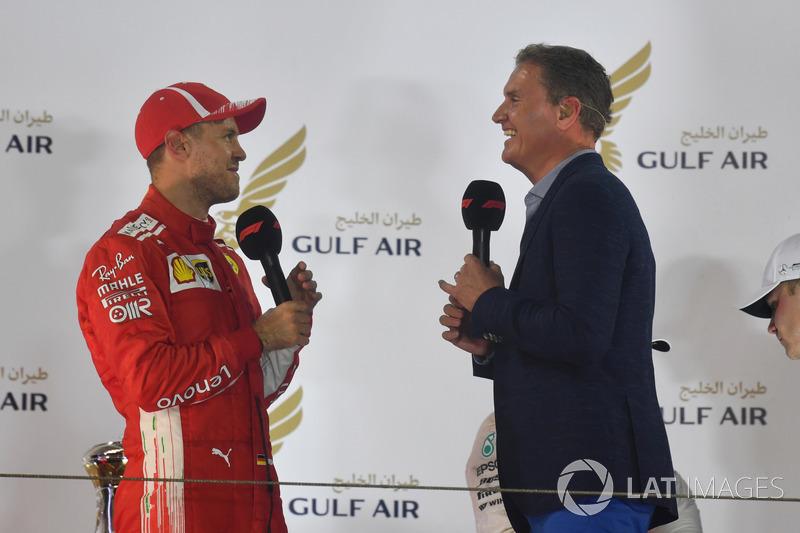 Sebastian Vettel, Ferrari talks with David Coulthard, on the podium