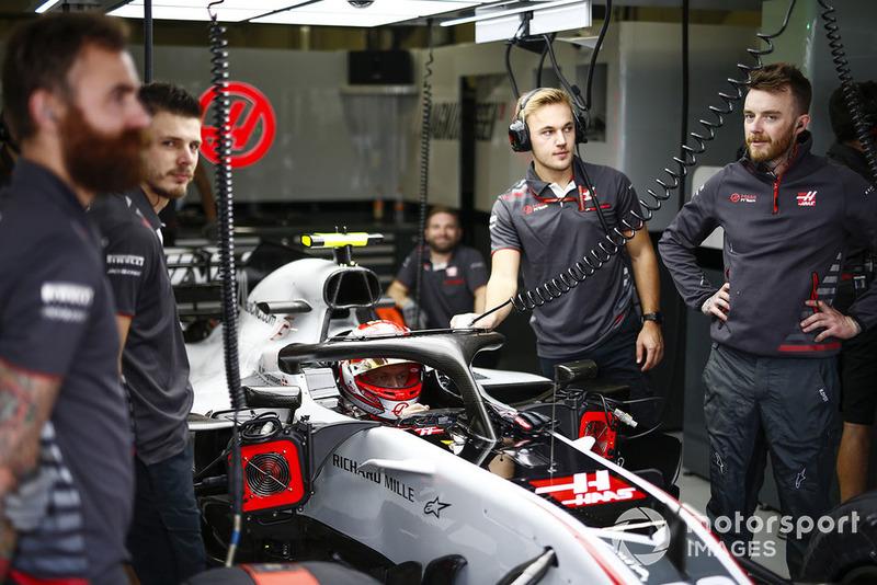 Kevin Magnussen, Haas F1 Team, in cockpit, in the team's garage