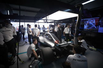 Engineers work on the car of Lewis Hamilton, Mercedes AMG F1