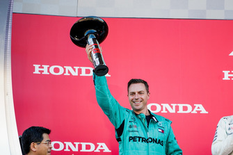 Mercedes receive the Constructors trophy on the podium