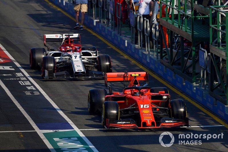 Charles Leclerc, Ferrari SF90, leads Kimi Raikkonen, Alfa Romeo Racing C38, in the pit lane