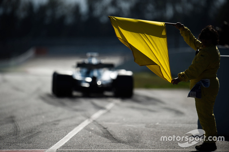 A marshal with a yellow flag