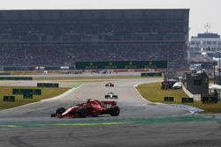 Sebastian Vettel, Ferrari SF71H, Valtteri Bottas, Mercedes AMG F1 W09, and Kimi Raikkonen, Ferrari SF71H