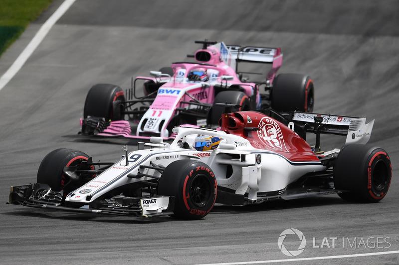Marcus Ericsson, Sauber C37 and Sergio Perez, Force India VJM11