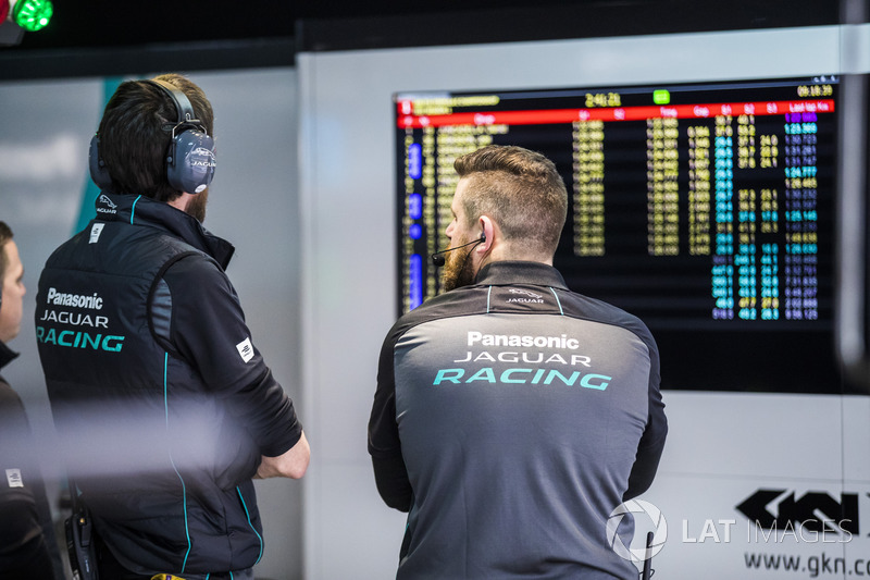 Jaguar mechanics watching the timing screens