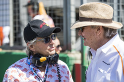 Actor Michael Douglas with Mansour Ojjeh, co-owner, McLaren