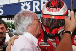 Kimi Raikkonen, Ferrari, talks to Bernie Ecclestone