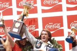 Podium: race winner Jacques Laffite, Ligier