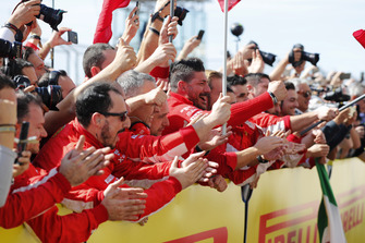 The Ferrari team cheer as Kimi Raikkonen, Ferrari SF71H, 1st position, arrives in Parc Ferme