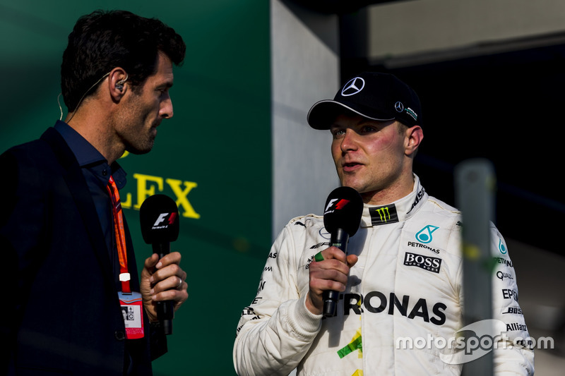 Valtteri Bottas, Mercedes AMG, 3rd Position, is interviewed by Mark Webber on the podium