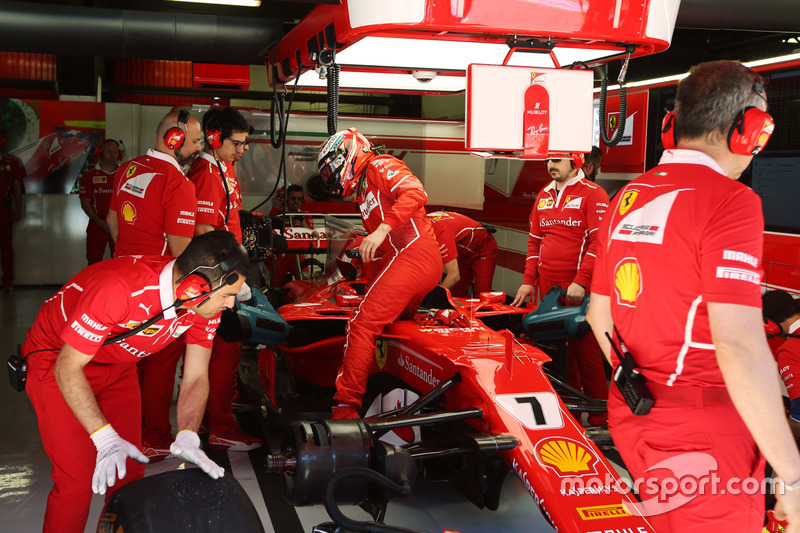 Kimi Raikkonen, Ferrari, climbs out of his car in the garage