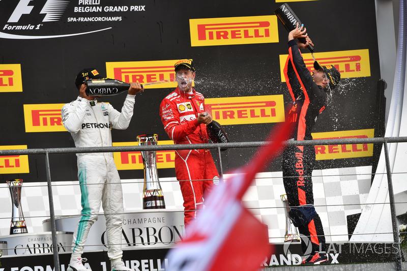 Lewis Hamilton, Mercedes AMG F1, Sebastian Vettel, Ferrari and Daniel Ricciardo, Red Bull Racing celebrate on the podium, the champagne