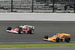 Johnny Rutherford, McLaren M16, and Mario Andretti, McLaren M24