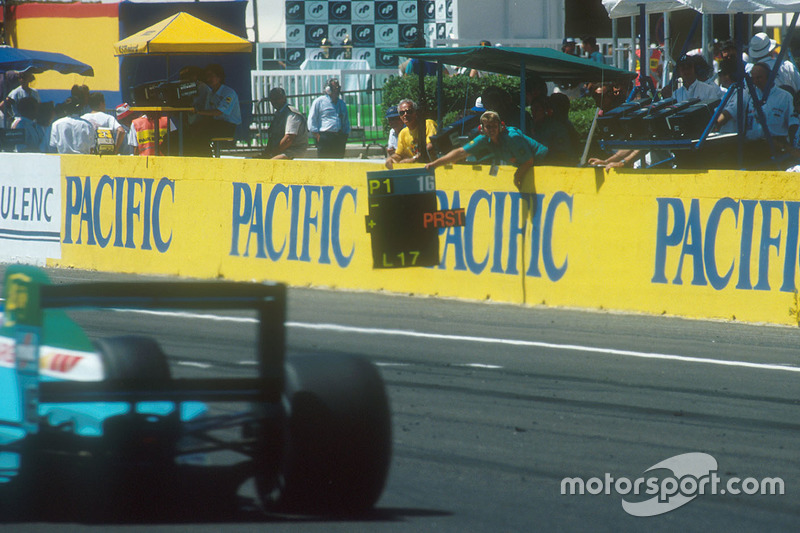 Ivan Capelli, Leyton House CG901 Judd passes his pit board, which tells him he is leading Alain Prost