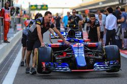 Scuderia Toro Rosso mechanics with Scuderia Toro Rosso STR12