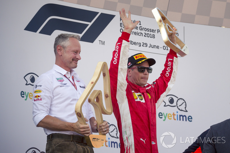 Jonathan Wheatley, Red Bull Racing Team Manager and Kimi Raikkonen, Ferrari celebrate on the podium