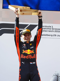 Max Verstappen, Red Bull Racing, 1st position, lifts his trophy on the podium