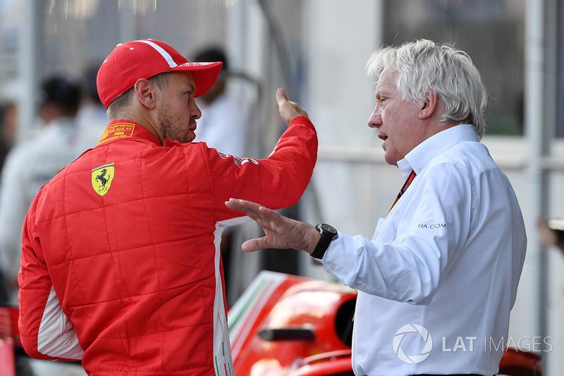 Pole sitter Sebastian Vettel, Ferrari and Charlie Whiting, FIA Delegate in parc ferme