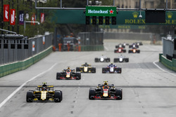 Carlos Sainz Jr., Renault Sport F1 Team R.S. 18, leads Max Verstappen, Red Bull Racing RB14 Tag Heuer, Daniel Ricciardo, Red Bull Racing RB14 Tag Heuer, and Nico Hulkenberg, Renault Sport F1 Team R.S. 18