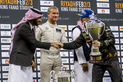 Runner up Petter Solberg is presented with his trophy by Abdulaziz bin Turki Al Saud