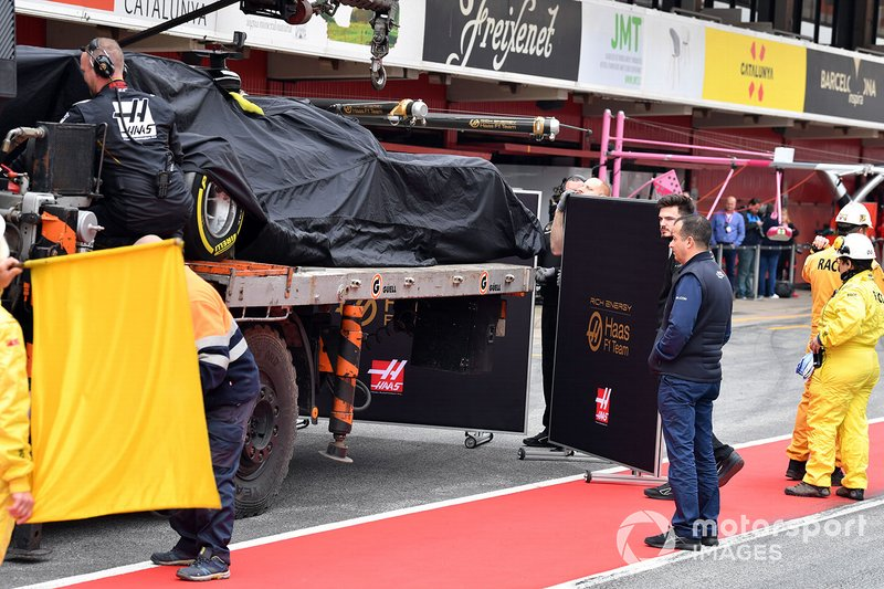 The car of Romain Grosjean, Haas F1 Team VF-19 is recovered to the pits