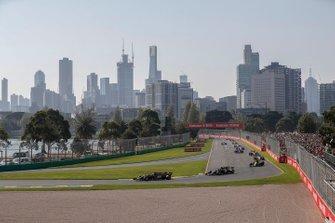 Kevin Magnussen, Haas F1 Team VF-19, leads Romain Grosjean, Haas F1 Team VF-19, Nico Hulkenberg, Renault F1 Team R.S. 19, Kimi Raikkonen, Alfa Romeo Racing C38, and Lando Norris, McLaren MCL34