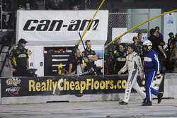 Carl Edwards, Joe Gibbs Racing Toyota walks down pit road after crashing
