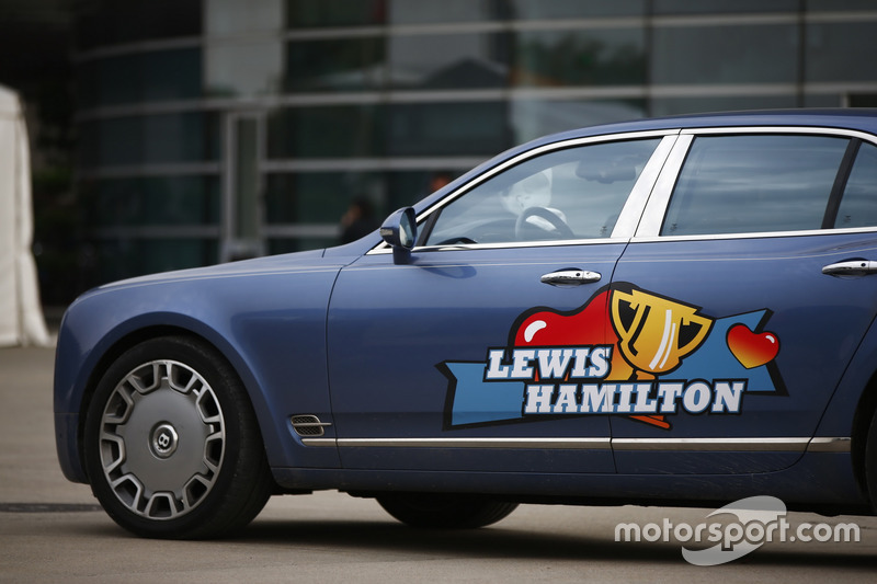 A Bentley with support for Lewis Hamilton, Mercedes AMG, emblazoned on it