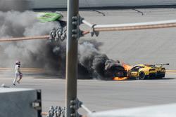 Marcel Fässler runs with a fire extinguisher to the #4 Corvette Racing Chevrolet Corvette C7.R on fire