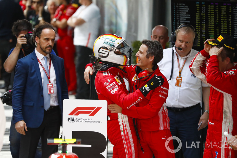 Race winner Sebastian Vettel, Ferrari, celebrates on arrival in Parc Ferme with Inaki Rueda, Race Strategist, Ferrari