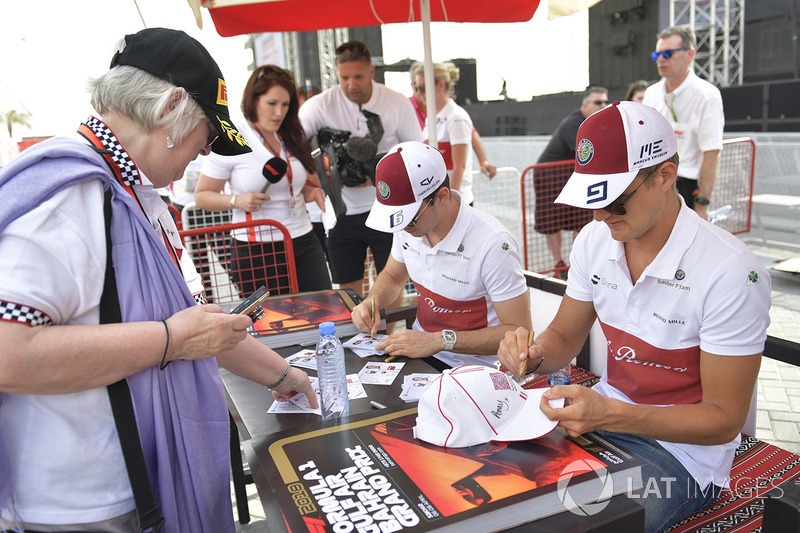 Charles Leclerc, Sauber and Marcus Ericsson, Sauber sign autographs for the fans