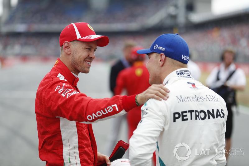 Обладатель поула Себастьян Феттель, Ferrari, второе место – Валттери Боттас, Mercedes AMG F1