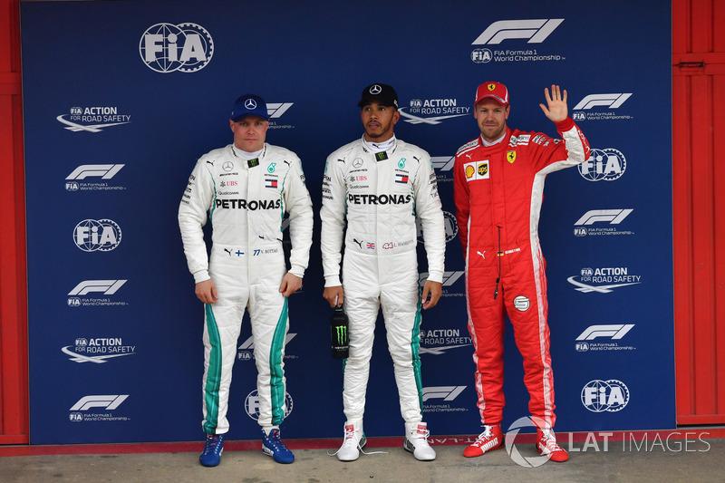 Valtteri Bottas, Mercedes-AMG F1,pole sitter Lewis Hamilton, Mercedes-AMG F1 and Sebastian Vettel, Ferrari celebrate in parc ferme